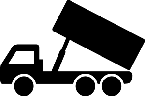 A dump truck dumping its payload